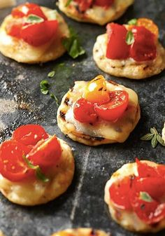 Impress your dinner party guests with these amazing Roasted Cherry Tomato Pizza Poppers! Reynolds Kitchens Tip: Cooking on Aluminum Foil will help your tomatoes absorb the delicious flavors of oil and seasonings.