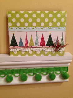 Christmas card - a line of multi-coloured paper trees with stars atop