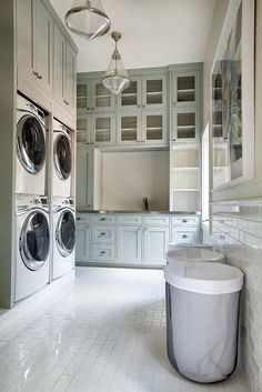 Love this laundry room!  Don't think I need two washers and two dryers, but I LOVE everything else.. really loving the metal baskets too!