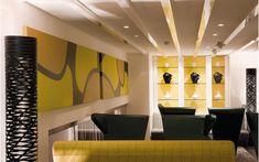 We are a global and creative design studio in Geneva, Tokyo and Beijing. Black Floor Lamp, Floor Lamps, Green Armchair, Interior Architecture, Interior Design, Black Sofa, Waiting Area, Hotel Lobby, Glass Shelves