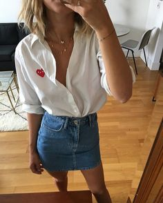 Pin for Later: All the Ways You Still Haven't Thought to Wear Your Denim Skirt With a Crisp Button-Down Blouse That's Come Undone