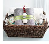 Guest basket:  In a basket or on a tray, present gifts like handmade coasters, ornaments and homemade candy. Or, go functional with towels, soap, tissues and items much needed for a stay away from home. Want to go the extra mile? Present fresh flowers in a vase.