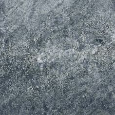 AZUL ARAN LEATHERED. Iridescent clusters of black and blue on a soft smoky blue white background in a textured finish. Gorgeous granite color available at Knoxville's Stone Interiors.  Showroom located at 3900 Middlebrook Pike, Knoxville, TN.  www.knoxstoneinteriors.com  FREE Estimates available, call 865-971-5800.