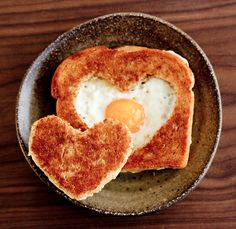 it's just so sweet to wake up to a heart-shaped egg in a basket