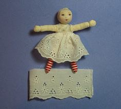 sew lace, fray check, gather around dolls waist. Arrange gathers mostly in front/back, less on the sides,