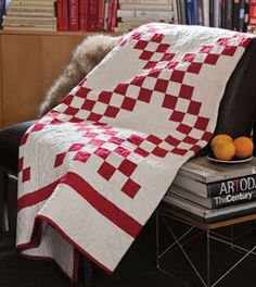 This traditional irish chain quilt pattern is made new with fresh modern red and white quilt fabrics. Perfect for quilters of any skill level.