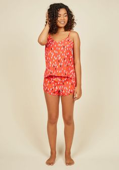 Lounging around the house in this coral pajama top is a dream all its own! A ModCloth-exclusive look designed for chill days in with its strappy, tied back, silky fabric, and colorful droplet print, this sleep tank satisfies your staycation style needs with restful indulgence.