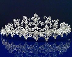 These jeweled tiaras are the perfect accessories for Weddings, Proms, Pageants, Parties, Birthday, or other special occasions. The SPARKLYCRYSTAL tiara comes in a keepsake presentation round clear pla
