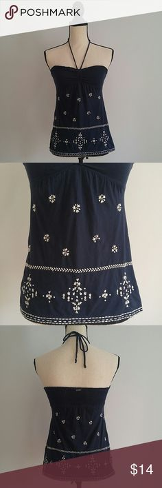 Abercrombie embroidered halter top Abercrombie and Fitch size xs navy blue embroidered halter top. Super cute and easy! Very pretty embroidered detail. One flower in the front is missing its petal (can be seen in picture #2). Add to a bundle :) Abercrombie & Fitch Tops