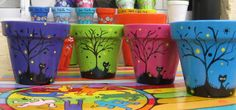 brightly painted flower pots with Halloween tree and black cat Flower Pot Art, Clay Flower Pots, Flower Pot Crafts, Clay Pots, Clay Pot Projects, Clay Pot Crafts, Diy And Crafts, Flower Pot People, Clay Pot People