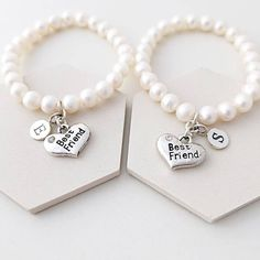 Sophie Jones Jewellery Best Friend Bracelet ($37) ❤ liked on Polyvore featuring jewelry, bracelets, heart jewelry, cream jewelry, initial bangle, heart bangle and freshwater pearl jewelry