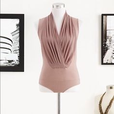 Nude color bodysuit NWT nude color bodysuit. Never worn and brand new! New York & Company Other