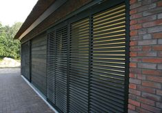 Wide choice of sliding shutters and facade screens Isoluik B. Service Design, Outdoor Shutters, Small Beach Houses, Window Grill, Long House, Metal Screen, Iron Gates, Patio Doors, Living Room Inspiration