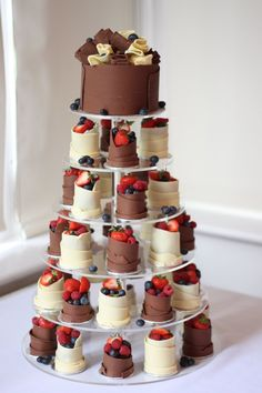 Layers of Loveliness Sweet As Cake Emporium specialises in chocolate work. To create this marvel, chocolate cakes were dipped in ganache, then wrapped in pure Belgian chocolate and finished with fresh summer berries.