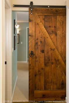 Reclaimed wood barn door used indoors - beautiful! | Postcard from New Energy Works Timberframers - July 8, 2013