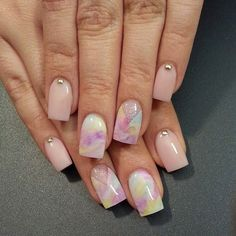 Elegant and soft looking watercolor nail art design. You can use nude colors for the matte parts and light pink, blue, yellow and violet for the soft watercolor gradient parts.