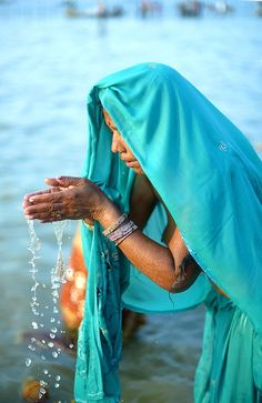 People of India, January Woman in prayer in the waters of the Sangam durin. People of India, January Woman in prayer in the waters of the Sangam during the Kumbh Mela in Allahabad. Hindus, Varanasi, A Passage To India, Kumbh Mela, Amazing India, India People, Turquoise, Teal, Blue