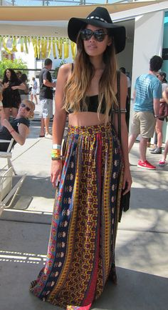 A printed maxi, floppy hat, and tiny bra top are the perfect trio of festival fashion.  Photo: Leah Melby