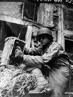 shookengraves:     9th US Army Signal man attached to an armored unit, test communication wires in a town in Germany. December 4, 1944