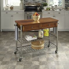 Inspired by 18th century French Creole Cottages, the slotted shelves and metal legs with cast feet and caps are reminiscent of French Quarter architecture. The Kitchen Cart by Home Styles is pefect addtion to any kitchen decor.
