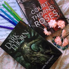Hello!! How's your weekend going? My weekend will be filled with reading and playing cello!! I hope I can finish ACOTAR today or tomorrow!!  #books #booklove #booknerd #booklover #bookstagram #reading #read #flowers #sheetmusic #cello #ilovereading #acotar #sarahjmaas #thedarkthorn by uponabookcastle