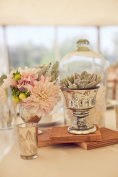 Blocks of wood to elevate centerpieces / Succulents/ Photography By / carliestatsky.com