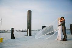 Boston Harbor   Wedding gown: Riki Dalal http://www.rikidalal.com   Grooms suit: J. Crew   Photo credit: Catalina Ayubi catalinaayubi.com