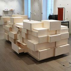 Drawer Kitchen includes a pile of drawers and a sink. The design appears as a series of different-sized, randomly stacked boxes from three of its sides. This functional kitchen also appears to be. Kitchen Colors, Kitchen Design, Kitchen Appliances Brands, Grand Designs Live, House Removals, Open Plan Kitchen Dining, Milan Furniture, Dezeen, Kitchen Items