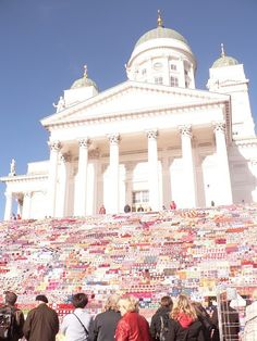 In Helsinki, Finland, local womens organization Martat alongside with the largest yarn manufacturer of the country Novita and craft teachers union covered the stairs of Helsinki Cathedral with thousands of granny square quilts. They were hand made by volunteers around the country. There were 3800 quilts, consisting out of 152 000 granny squares, covering the stairs. They actually managed to get together 7800 of these quilts, but couldn't fit them all on the approx 50x28m stairs!