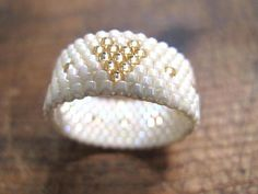 This ring is crafted by me in Switzerland. It is composed of Miyuki delica beads. It is light to wear Width of the ring about 0.9 cm Fits ring size from approx. 55 - 57
