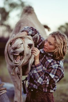Robyn Davidson has traveled thousands of miles on camels - alone - across the deserts of Australia and Africa. Robyn Davidson, Europe On A Budget, Budget Travel, Travel Alone, Adventure Is Out There, Africa Travel, Pet Birds, Amazing Women, Creatures