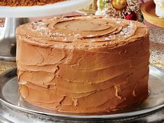 Sea Salt-Caramel Cake Recipe | While these tender cake layers taste divine, it's the caramel frosting that really wows. It's outrageously rich— and doesn't require the use of a candy thermometer. Top the frosted cake with a sprinkle of flaky sea salt for a fancy finish. Your guests will love this cake during the holidays, but you might get requests for it year-round.