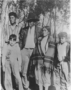Baldwin Parker with his wife, Nora Acquitsaketah-Parker, and their three sons - Comanche - no date {Note: Baldwin Parker was the son of Quanah Parker and Chonie.}