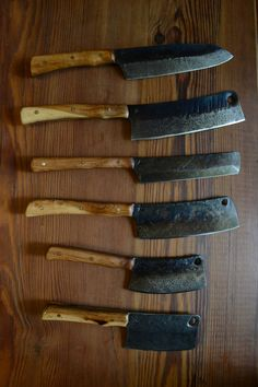 "New Damascus Knives w/ Pacific Yew handles From the top: 8"" Santoku, 8"" Cleaver/ Butcher Hybrid, 7"" Vegetable Nakiri, 6.5&..."