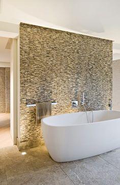 Bathtub & stone wall