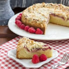 Scrumptious coffee cake with layers of cream cheese, berries and streusel.