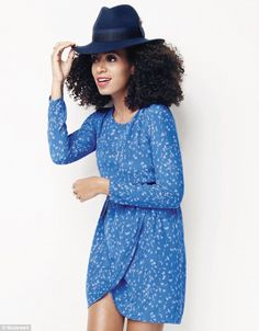 Hipster: The singer's trademark afro is seen beneath a blue fedora, which has been paired with a blue print frock.