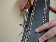 Guitar strap decorated with border line.