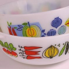 is it pyrex?  if so - LOVE. It is JAJ Pyrex, a European distribution . . . they tend to have multiple colors which are brighter than American Pyrex and tend to be printed on white pyrex
