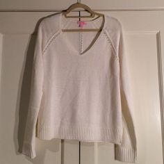 Lilly Pulitzer White Knit Sweater, L, NWT Brand new from this past season white knit sweater in size large. Never been worn. Tags not attached but are included. Ribbed hem and sleeve cuffs. Lilly Pulitzer Sweaters Crew & Scoop Necks