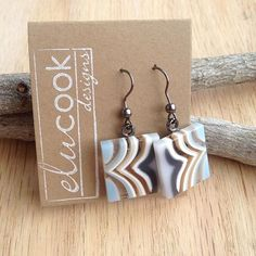 Fused glass earrings by Emily L. U. Cook of eluCook Designs. Follow on Facebook at www.facebook.com/elucookdesigns to purchase. Also find her work on Instagram @elucookdesigns or on the web at www.elucookdesigns.com