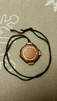 the front half of a medallion I made for my son.  the wood is bloodwood, the metal is copper.  all are finished with lacquer.