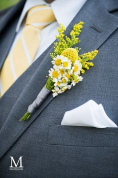 Yellow Spring Inspired Boutonniere. This Las Vegas wedding paired gray suits and yellow pops of color. Photo By M Place Productions See the entire featured real in our latest issue of Spectacular Bride Magazine. To request a copy www.spectacularbride.com