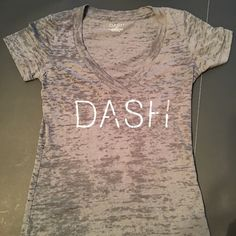 Kardashian Fans! DASH tshirt from DASH store! SZ S These tshirts, like everything else in the DASH store are pricey! Here is an authentic DASH shirt, you don't have to have the bank account of a Kardashian to afford!! Excellent condition!! Dark Grey as in pics 2-4 DASH Tops Tees - Short Sleeve