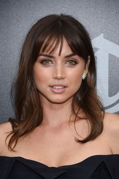 Ana de Armas Medium Wavy Cut with Bangs - Ana de Armas looked oh-so-pretty with her wavy locks and wispy bangs at the premiere of 'Hands of Stone.'
