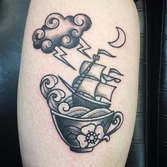 american traditional boat in a storm in a teacup tattoo