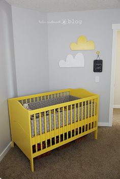 Yellow crib and cute clouds