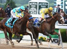 Union Rags (3), with jockey John Velazquez aboard, overtakes Paynter (9) and jockey Mike Smith to win the 144th running of the Belmont Stakes.