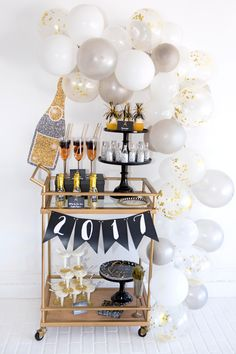 Celebrate the new year with a fabulous Black, Gold & Silver New Year's Eve party! Get party ideas, DIYs, a champagne cocktail recipe and FREE Printables.