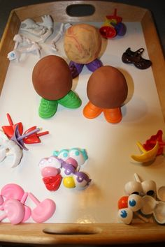 Playdough Mr. Potato Head fun!  This is a great idea, especially when the youngsters don't have the fine-motor skills to get the pieces in and out of the holes in the plastic potato!  I wish I'd thought of this earlier!
